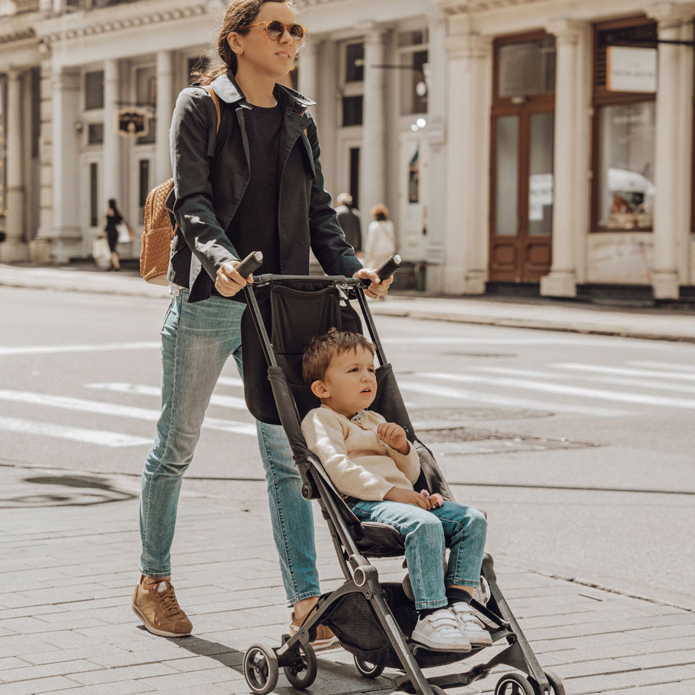 mom with son in stroller walking